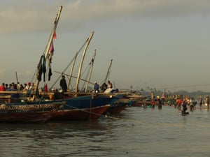 Boats line the shore to offload their catch at Kivukoni fish market in Dar es Salaam