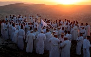 Samaritans gather to pray on top of Mount Gerizim as they celebrate the Shavuot festival at dawn in Nablus, West Bank