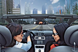 Two women enjoy a drive in the Pudong district, Shanghai