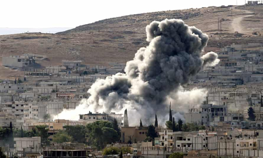 A US-led air strike in October in Kobani, Syria, during fighting between Syrian Kurds and Islamic State. Chris Woods, of Airwars, said: 'You can't have an air war of this intensity without civilians getting killed or injured.'