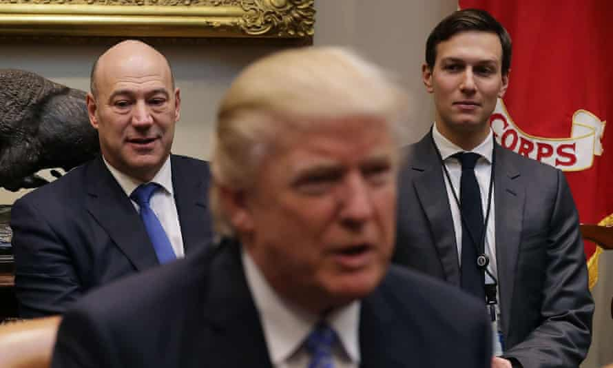 Former Goldman Sachs banker Gary Cohn, left, now Trump's senior economic adviser, flanks the president during a meeting with business leaders in the White House.
