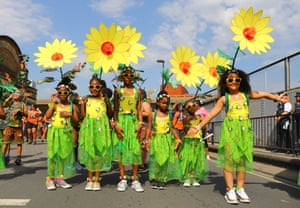 Children come to the carnival dressed as flowers