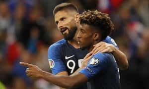 France's Kingsley Coman, right, celebrates his opening goal with France's Olivier Giroud.