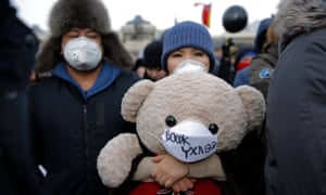 Protesters march in Ulaanbaatar on 28 January to demand government action to reduce air pollution.