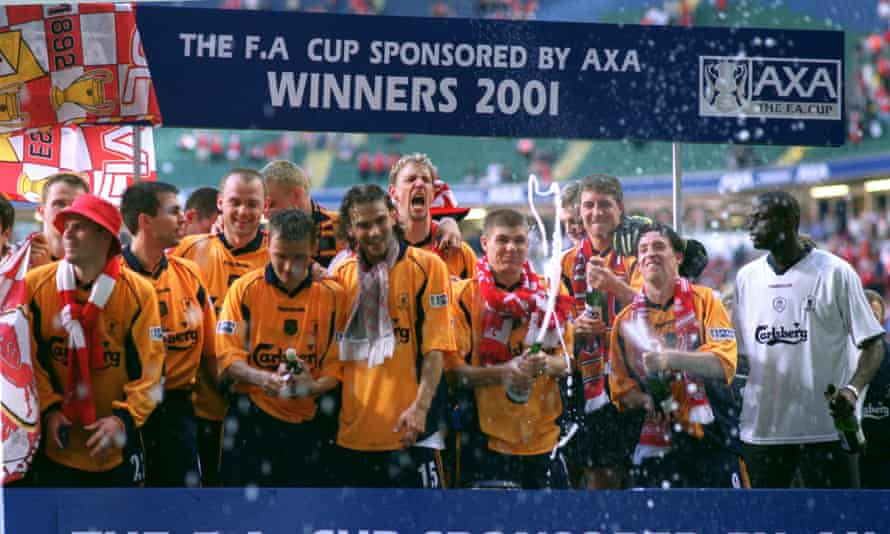 Liverpool celebrate their victory over Arsenal in the 2001 FA Cup final at Cardiff's Millennium Stadium