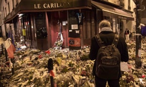 Flowers, candles and messages pile up outside Le Carillon restaurant in Paris, site of a terrorist attack on 13 November.