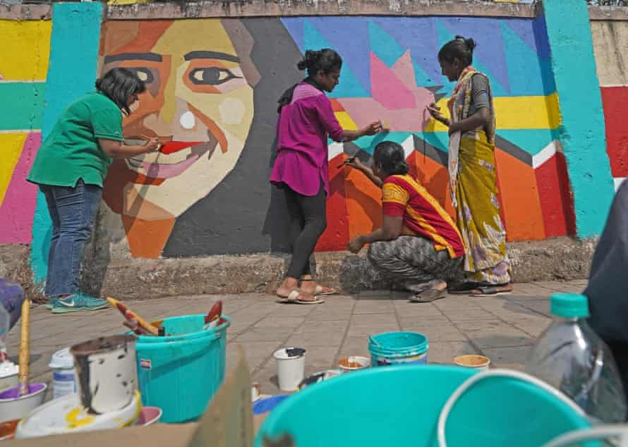 Members of Yaariyan, the youth initiative of the Humsafar Trust, paint a mural called Queering The City outside the gates of Sion Hospital in Mumbai, India.