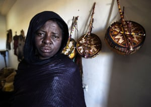 A Tuareg woman who is an imzad instrument maker poses for a picture