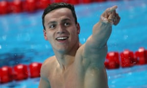 James Guy celebrates becoming the first British man to win a world freestyle title in Kazan.