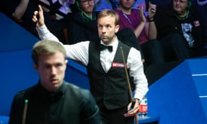 Ali Carter celebrates beating Jack Lisowski at the World Snooker Championship and afterwards said: 'I felt like I outplayed him and he's so talented, he's Ronnie O'Sullivan all over again.'