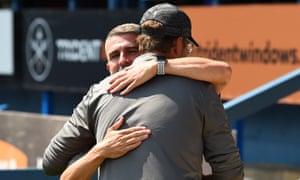 Ryan Lowe and Jürgen Klopp embrace at July's friendly.