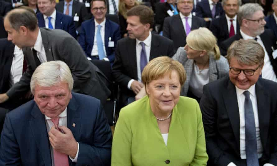 Chancellor Angela Merkel between the CEO of Deutsche Boerse, Theodor Weimer (right) and Hesse's prime minister, Voilker Bouffier (left)