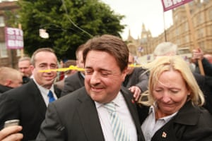 British National Party leader Nick Griffin is pelted with eggs as demonstrators try to disrupt a press conference outside Parliament in 2009. Griffin was bundled into a car and driven away.