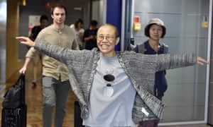 Liu Xia smiles as she arrives at Helsinki airport on her way to Berlin