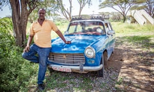"Belete Mulatu stands in front of his taxi, which he believes won't be on the road much longer. ""They won't be on the road more than two or three years,"" he says. ""The new Prime Minister will change things."" Taxis in Ethiopia"