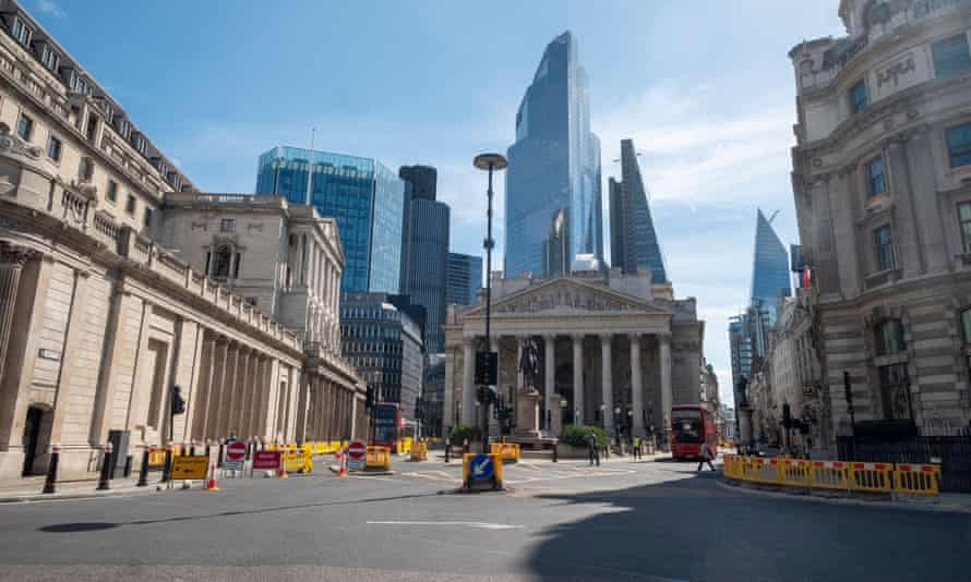 The Bank of England amid the tall towers of the City of London financial district.