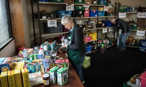 A volunteer prepares parcels at a food bank as demand soars.
