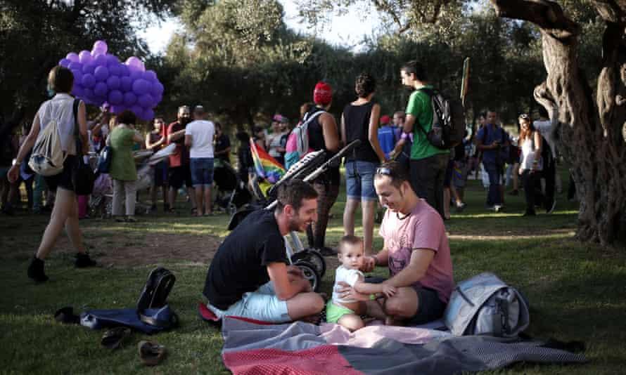 People in a park before Jerusalem gay pride parade in 2014