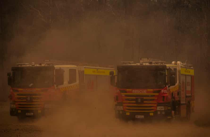 The southerly wind hits the rugby club on Saturday which is the staging area for emergency services for Nowra, blowing dust across the fire trucks.