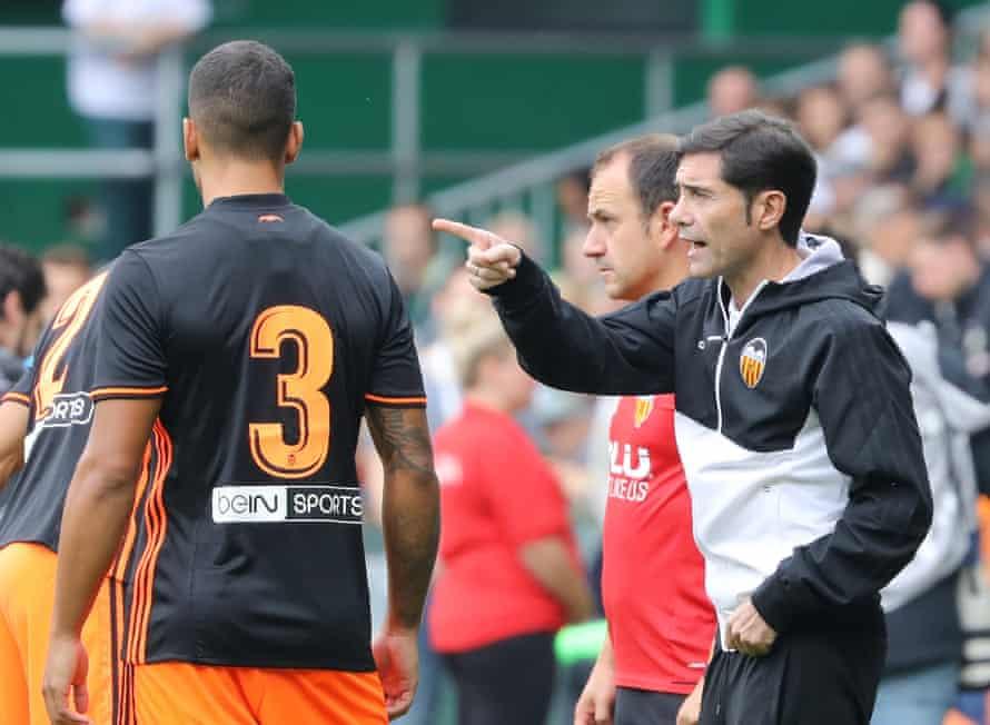 Valencia's coach Marcelino Garcia instructs Ruben Vezo during a pre-season friendly against Werder Bremen