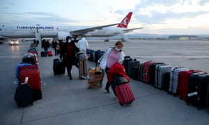 Turkish expats get off a plane from London to Ankara, Turkey.