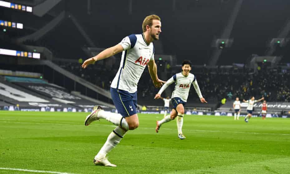 Harry Kane celebrates scoring against Arsenal.