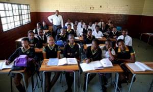 Teacher Reginald Sikhwari with students at Sekano-Ntoane school
