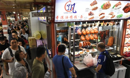 Customers queue at the Michelin-starred Hong Kong Soya Sauce Chicken Rice and Noodle stall.
