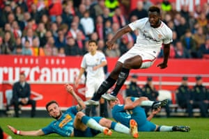 Sevilla's Joris Gnagnon jumps over Saúl and Rodri.