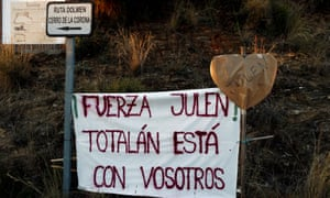 "A banner that reads ""Strength Julen! Totalan is with you"", is seen at the area where the Spanish two-year-old boy fell into a deep well"