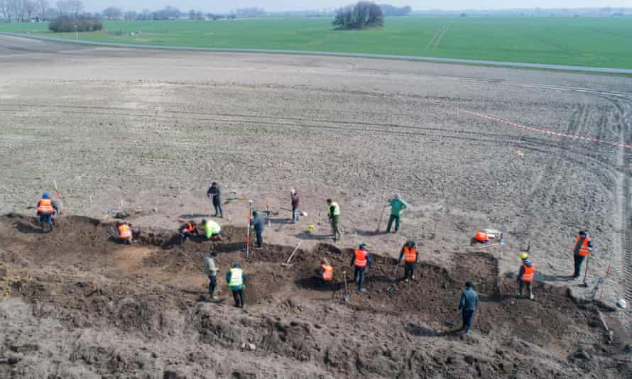 Archaeologists working on the dig on Rügen island after the find by René Schön and Luca Malaschnitschenko.