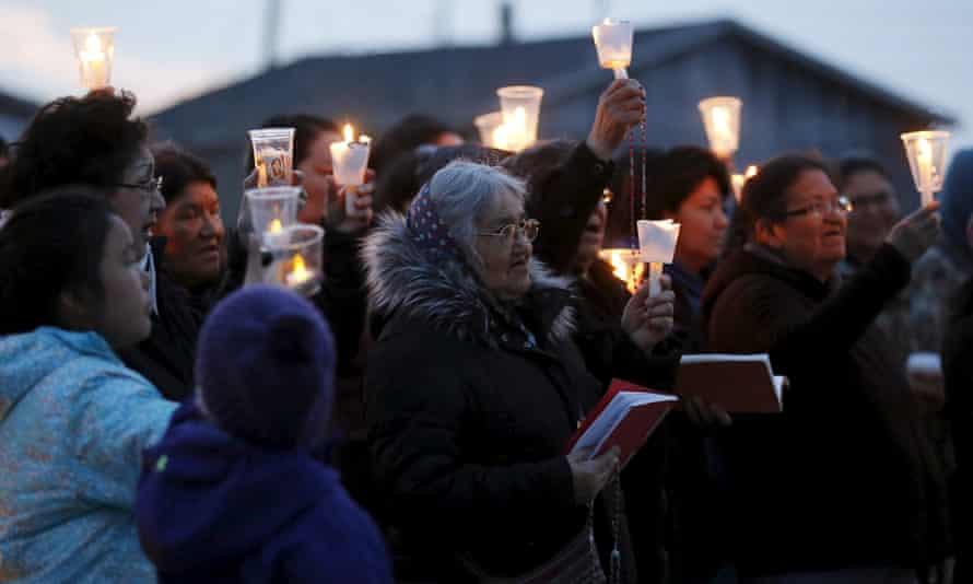 People take part in a candlelight vigil Attawapiskat.