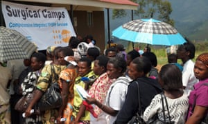 Women queue to receive HIV and cervical cancer counselling and testing, and to learn more about available family planning services, at a clinic in Kanungu, Uganda