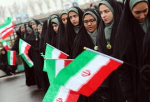 Students holding Iranian national flags