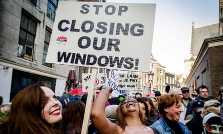 Sex workers protest against the closure of window brothels in Amsterdam.