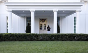 A Marine stands guard outside the West Wing, where Trump is still supposedly under quarantine.