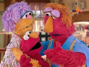 Sesame Street's Elmo with his parents.