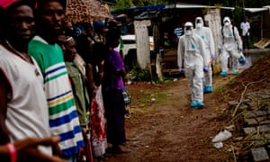 An Ebola safe burial team at work in Freetown, the capital of Sierra Leone