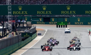 The cars leave the grid at the start of last year's British GP at Silverstone. Lewis Hamilton said the surface was the bumpiest he had ever experienced.