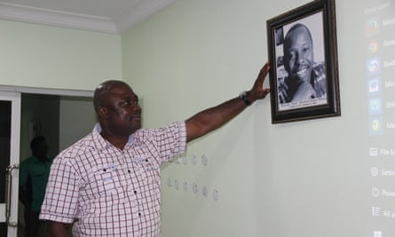 Human rights champion Patrick Naagbanton, with a portrait of his mentor, Ken Saro-Wiwa, the Ogoni activist executed by the Nigerian government in 1995.