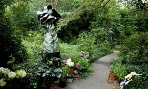 Down the path: scultpures compete for space in the garden.