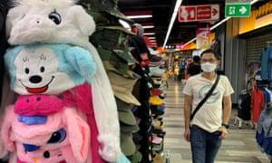 A man walking through a shopping mall in Bangkok on Saturday.