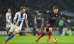 Arsenal's sub and birthday boy Aaron Ramsey surges forward with the ball past Brighton's Dale Stephens.