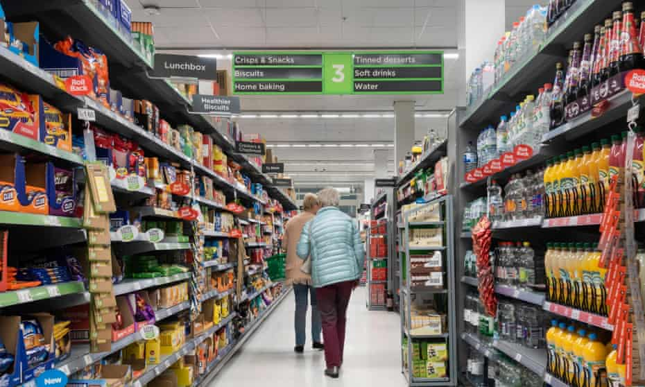 Shoppers in a supermarket aisle