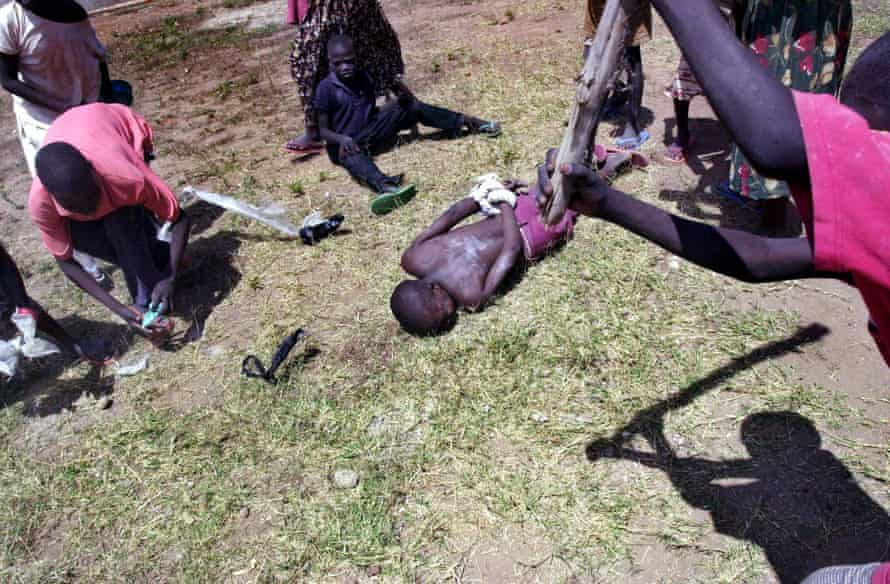 Ugandan children abducted and forced to fight by the LRA pretend to beat and abuse each other during war games at the Rachele rehabilitation centre in Lira in 2004.
