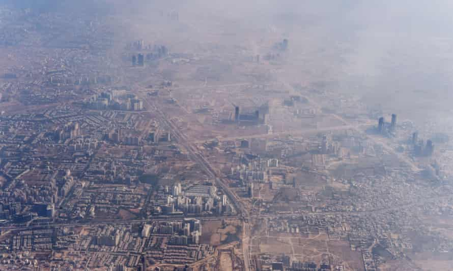 Smog enveloping buildings on the outskirts of Delhi