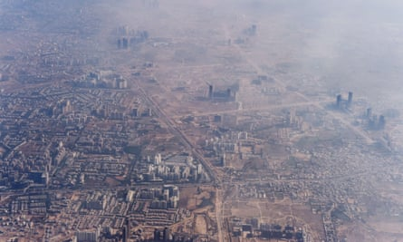 Smog envelops buildings on the outskirts of New Delhi.