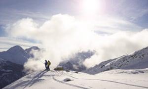 Two skiers off piste in Switzerland