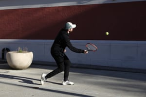 """Gus Jacobs, 27-years-old, hits a tennis ball against a school building in Williamsburg, Brooklyn. """"I'm just hitting a tennis ball against the wall. Normally, I play tennis with other people. I live right here, so once a day, I'm out doing this."""""""