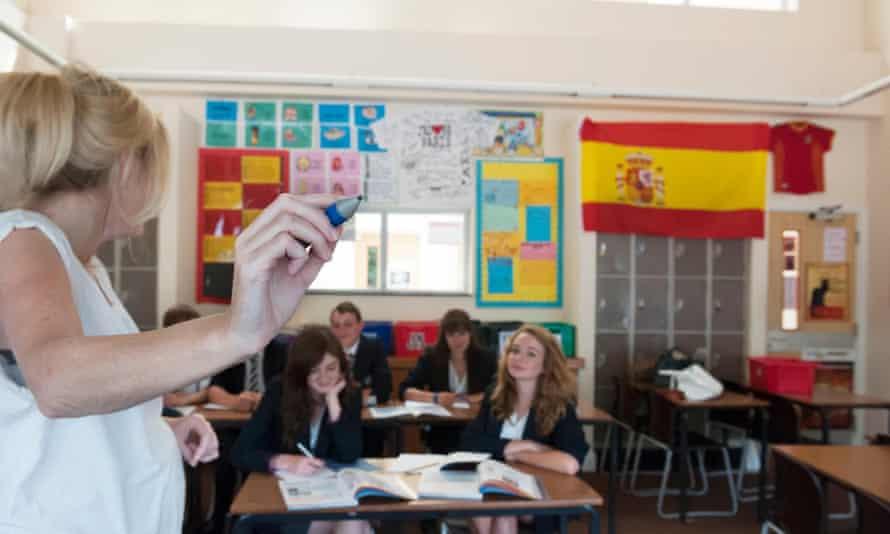 A teacher takes a class